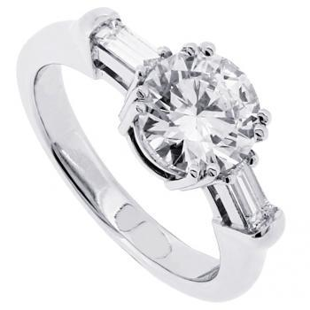 ring with central brilliant cut diamond and two baguettes as sidestones