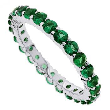 eternity ring fully set with round emeralds