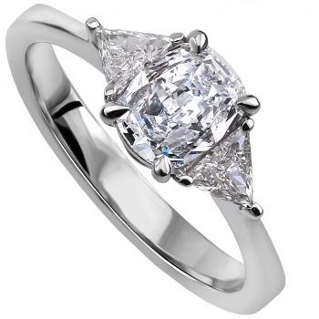 ring with a cushion cut diamond & 2 trilliant shaped diamonds on the side