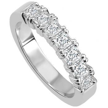 handmade wedding ring with princess cut diamonds set with four prongs per diamond