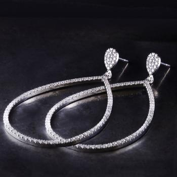 earrings with pear shaped with brilliant cut diamonds castle set dangling on a smaller drop shaped part