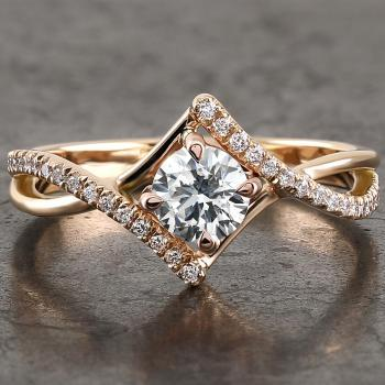 solitaire ring with a brilliant cut diamond set with four claws between a splitted band