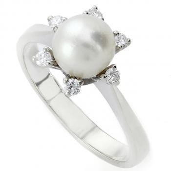pearl ring with brilliant cut diamonds surrounding a freshwater pearl