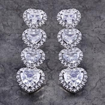 halo set earrings with heart cut diamonds surrounded with smal brilliant cut diamonds