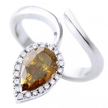 halo ring with fancy deep brownish Orangy Yellow pear cut diamond surrounded by smaller brilliant cut diamonds