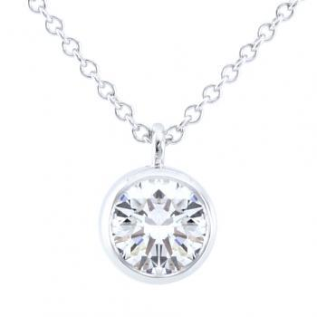 solitaire necklace with a brilliant cut diamond set into a pot with a very fine thin edge attached to a chain with a very fine ring