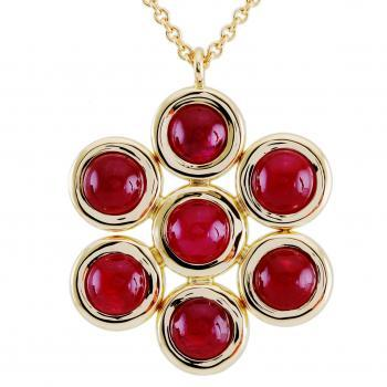 entourage pendant with round cabochon cut rubies set in donuts