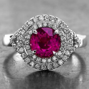 doulbe halo ring with a round natural untreated deep pink free of inclusions and two rows of castle set brilliant cut diamonds mounted on a split band