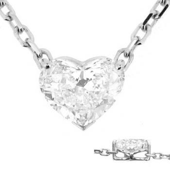 pendant with a heart cut diamond set in a V-prong & 2 round prongs