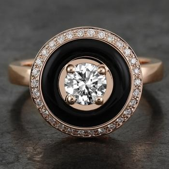 halo ring  with a brilliant cut diamond in the middle and surounded by an onyx ring and smaller pavé set diamonds