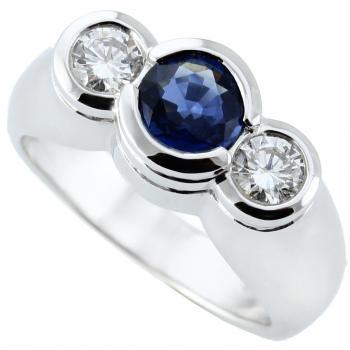 trilogy ring with a central sapphire flanked by two brilliant cut diamonds