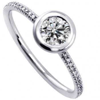 solitaire ring with a brilliant cut diamond set in a donut with a thin border mounted on a round thin band with two rods and set with smaller brilliant cut diamonds
