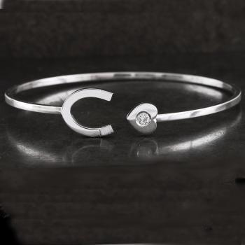 souple bangle bracelet with a horseshoe and a heart american set with a brilliant cut diamond