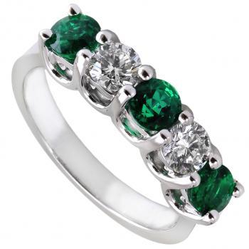 handmade complex anniversary ring with larger brilliant cut diamonds and emeralds set with two prongs between each two diamonds on double roundels
