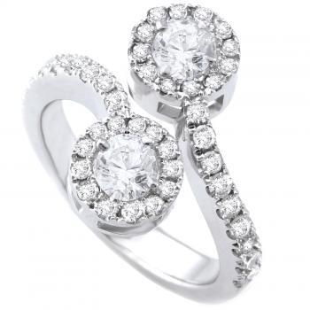 toi et moi halo ring with brilliant cut diamond surrounded by smaller brilliant cut diamonds
