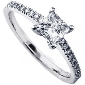 solitaire ring with a central princess cut diamond with smaller castle set diamonds on the band