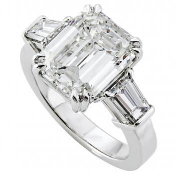 ring with an emarald cut diamond and 2 tapered baguettes on the side