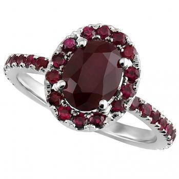halo ring with oval central ruby surrounded with smaller rubies on band