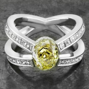 ring met ovale fancy yellow princess geslepen diamanten gekruist opzij