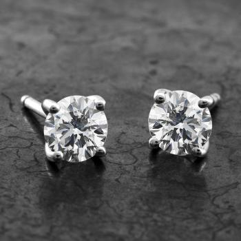solitaire earrings with brilliant cut diamonds set in 4 rounded curved prongs
