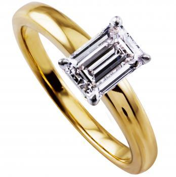 solitairering with an emerald cut diamond lower set in four prongs on a rounded band