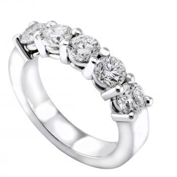 anniversary ring with five larger brilliant cut diamonds set with two prongs on double roundels