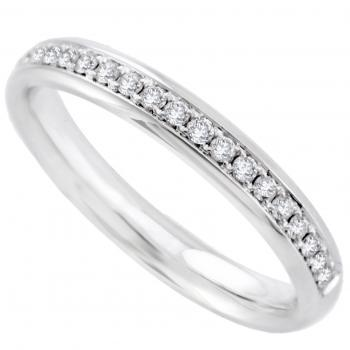 eternity ring slightly rounded inside and outside, and half covered with small brilliant cut diamonds