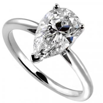 ring brilliant with a pear cut diamond set in three prongs on a rounded shank with palmets