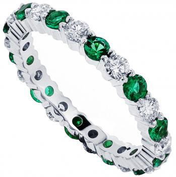 eternity ring fully set with round emeralds and brilliant cut diamonds