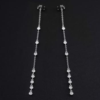 long earrings with brilliant cut bezel set diamonds connected with a rolo chain