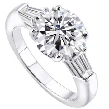 solitaire ring with a central brilliant cut diamond with 2 tapered baguettes on the side