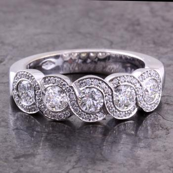 alliance ring set with larger brilliant cut diamonds set in S shaped settings and accentuated by smaller brilliant cut diamonds