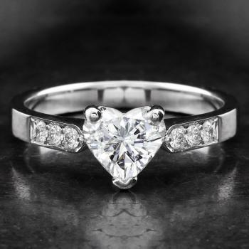 solitaire ring for a heart shaped diamond with smaller brilliant cut diamonds on the side