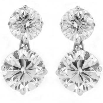 earrings with each side two brilliant cut diamonds one beneath the other