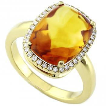 ring with a cabochon cut citrine surrounded with brilliant cut diamonds