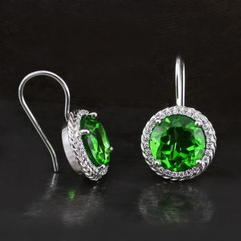 entourage earrings with centrally set green moldavite surrounded or halo set by smaller brilliant cut diamonds and surrounded by a twisted wire on a hook system