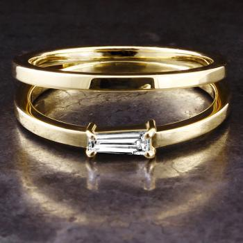 two fixed rings with one ring set with a tapered cut diamond