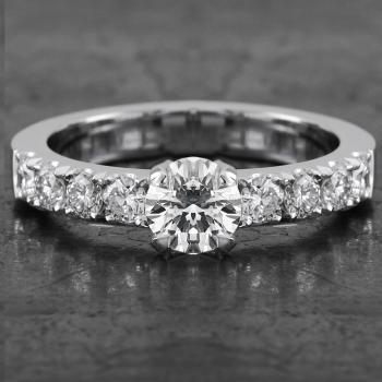 solitaire ring with a brilliant cut diamond  and castle set diamonds on the side