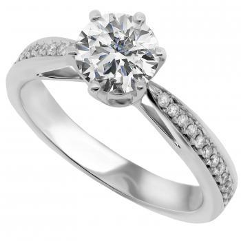 solitaire ring with a brilliant cut diamond and set aside with smaller brilliants
