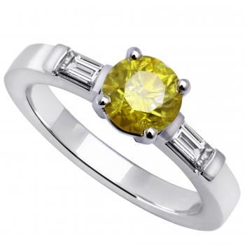 ring with a brilliant cut fancy yellow diamond set four prongs flanked by two baguette cut diamonds
