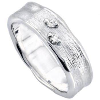 wedding ring with two brilliant cut diamonds on a capricious band with organic borders