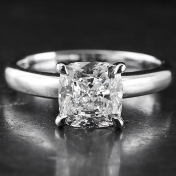 handmade solitaire ring with a cushion cut diamond set in 4 prongs rounded setting made of round wire