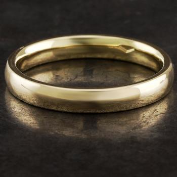 wedding ring slightly rounded aside, flat on the side and also the inside slightly rounded