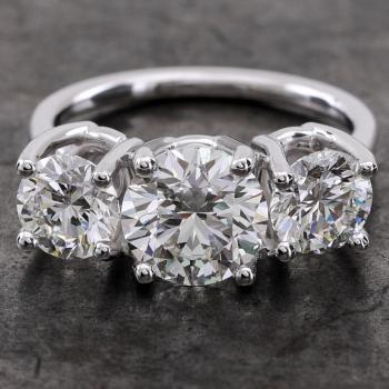 wedding ring trilogy with dire brilliant cut diamonds set in U-shaped prongs without roundel so open aside