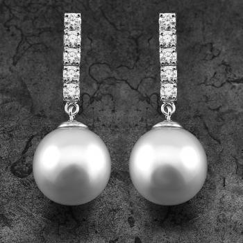 pearl earrings with round white freshwater pearls from about 9.5 to 10mm moving on a row of five brilliant cut diamonds set with prongs