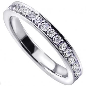 hand made wedding ring half set with brilliant cut diamonds set in pavé