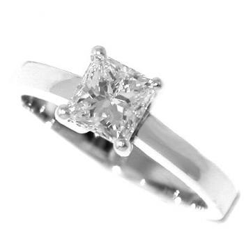 solitaire ring with a princess cut diamond set in four prongs on a slim band
