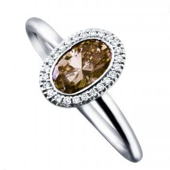 halo ring with an oval fancy brown diamond american set and mounted on a round thin band with two rods and surrounded with smaller brilliant cut diamonds