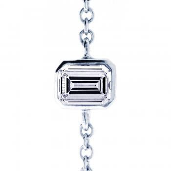 bracelet with an emerald cut diamond set in a conic bezel setting