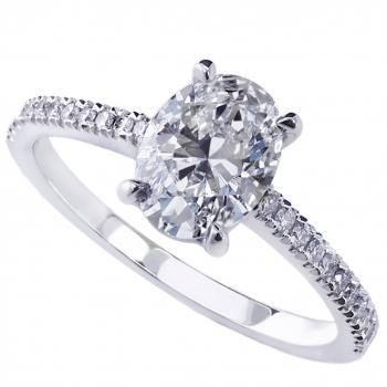 solitaire ring with a central oval cut diamond with smaller diamonds on the side castle setted a thinner band